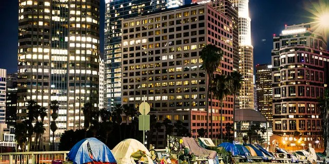 Skyscraper tents are depicted near the highway in LA downtown with skyscrapers.  (IStock)