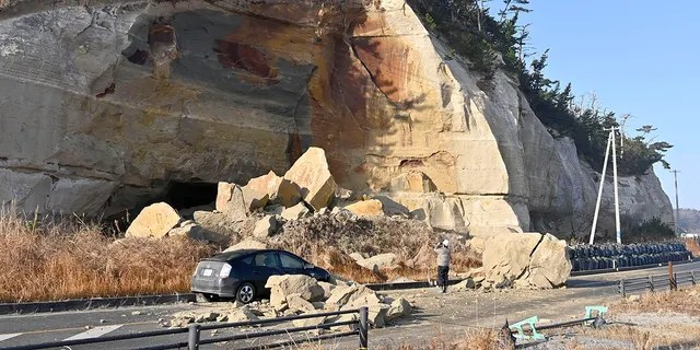 Collapsed rocks block a road after a strong earthquake hit Soma city, Fukushima prefecture, northeastern Japan, Sunday, Feb. 14, 2021. (Associated Press)