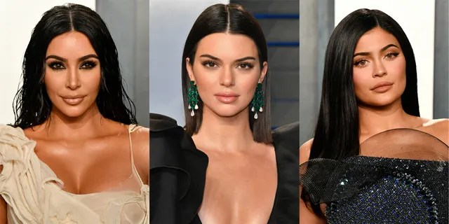 Kim Kardashian, left, teamed up with her younger sisters Kendall Jenner, center, and Kylie Jenner to promote her new lingerie line.