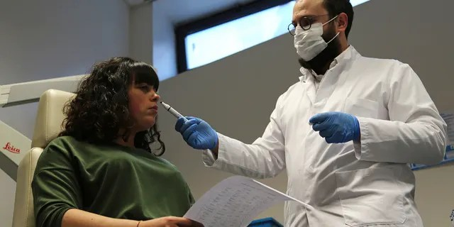 February 8, 2021: dr.  Claire Vanderstein, right, during a test at a hospital in Nice, southern France, helps detect the smell of a tube under the nose of a patient, Gabriela Forgione, to help determine that she was unable to smell Yes or No.  In November 2020, it signed COVID-19.