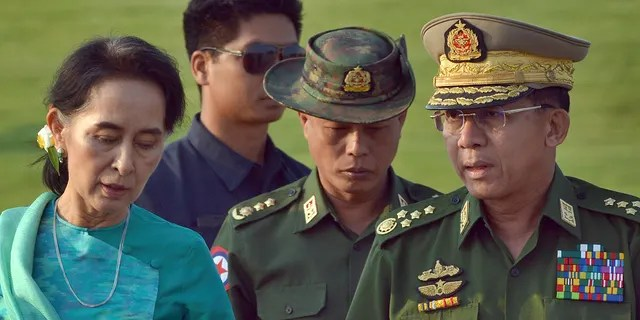 FILE - In this May 6, 2016, file photo, Aung San Suu Kyi, left, Myanmar's foreign minister, walks with senior General Min Aung Hlaing, right, Myanmar military's commander-in-chief, in Naypyitaw, Myanmar.(AP Photo/Aung Shine Oo, File)