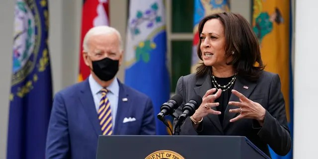 FILE: President Joe Biden listens as Vice President Kamala Harris speaks about the American Rescue Plan, a coronavirus relief package, in the Rose Garden of the White House in Washington. (AP Photo/Alex Brandon, File)