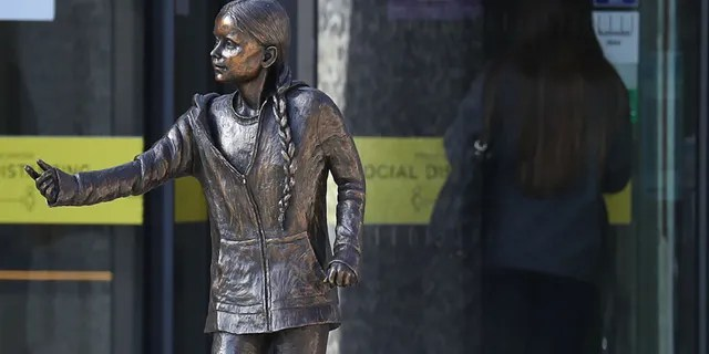 A statue of climate change activist Greta Thunberg has been installed outside the University of Winchester's West Down Centre in Winchester, Hampshire on Tuesday, March 30, 2021. (Photo by Andrew Matthews/PA Images via Getty Images)