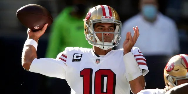 In this Sunday, Nov. 1, 2020, file photo, San Francisco 49ers quarterback Jimmy Garoppolo passes against the Seattle Seahawks during the first half of an NFL football game in Seattle. (AP Photo/Scott Eklund, File)