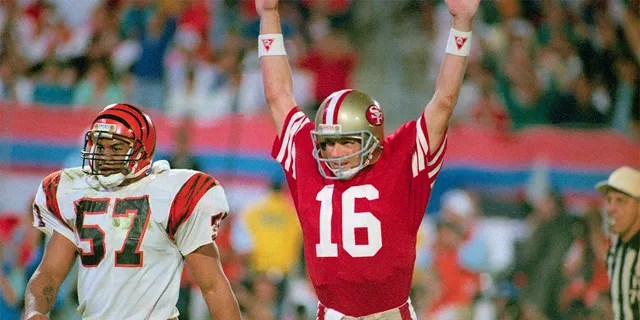 49ers quarterback Joe Montana raises his arms in celebration after throwing a touchdown pass to Jerry Rice.