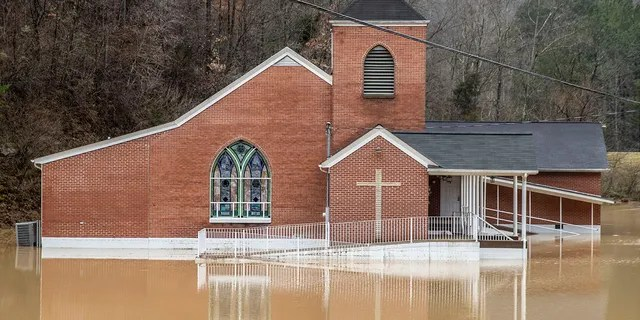 Authorities said flood waters rained heavily around the Rockhouse Freeville Baptist Church on Johnson County, Ky., On Monday, March 1, 2021.  (Via Ryan C. Hemmens / Lexington Herald-Leader AP)