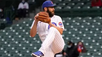 Arrieta pitches Cubs to 3-1 win over Mets on cool night