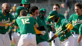 A's extend winning streak to 11, helped by 2 errors in 10th