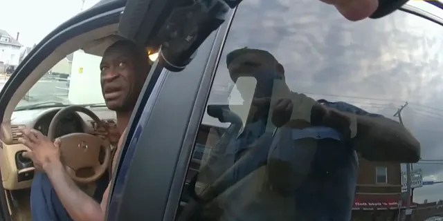 In this image from police body cam video, a Minneapolis police officer approaches George Floyd with a gun drawn, on May 25, 2020, outside Cup Foods in Minneapolis. (Court TV via AP, Pool)