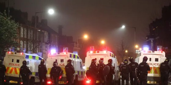 Police move to separate nationalists and legalists after they clashed at the peace wall on Lanark Way in West Belfast, Northern Ireland, Wednesday, April 7, 2021. The police had to close roads to the area Protestant coming as crowds of each split were attacked.  (Associated Press)