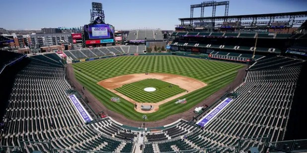 Workers prepare Coors Field on Wednesday, March 31, 2021, in Denver, the day before the Colorado Rockies' season opener against the Los Angeles Dodgers.  (Associated Press)