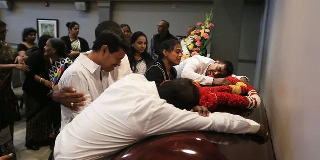 Kirushnakumar Kanagaratnam's family mourns next to his coffin.  Kanagarathnam.  Bruce McArthur was charged with first degree murder upon his death.