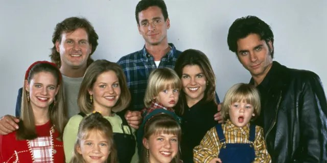 The 'Full House' cast is pictured on August 30, 1993. Front: Mary-Kate/Ashley Olsen; Jodie Sweetin. Middle: Andrea Barber, Candace Cameron, Lori Loughlin, Dylan/Blake Tuomy-Wilhoit. Back: Dave Coulier, Bob Saget, John Stamos.