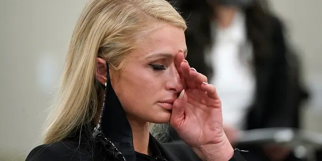 Paris Hilton wipes her eyes after speaking at a committee hearing at the Utah State Capitol, Monday, Feb. 8, 2021, in Salt Lake City. Hilton has been speaking out about the abuse she says she suffered at a boarding school in Utah in the 1990s and she testified in front of state lawmakers weighing new regulations for the industry.