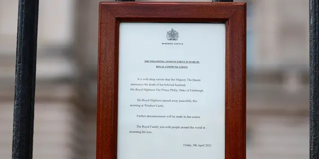 An announcement is displayed at the fence of Buckingham Palace after it was announced that Britain's Prince Philip, husband of Queen Elizabeth, has died at the age of 99, in London, Britain, April 9, 2021.