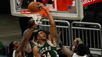 Antetokounmpo scores 49 points as Bucks beat Nets 117-114