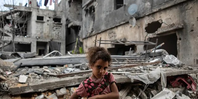 Palestinian Rahaf Nuseir, 10, looks on as she stands outside her family's destroyed homes, to which they returned following a cease-fire reached after an 11-day war between Gaza's Hamas rulers and Israel, in town of Beit Hanoun, northern Gaza Strip, Friday, May 21, 2021. (Associated Press)