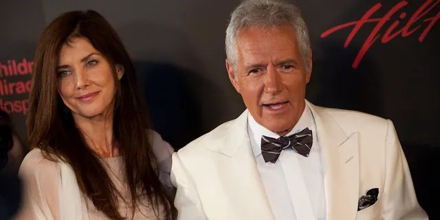 Actor Alex Trebek (R) and wife Jean Currivan Trebek arrive at the 38th Annual Daytime Emmy Awards show in Las Vegas, Nevada, on June 19, 2011. Alex Trebek died in November at the age of 80 after battling pancreatic cancer.