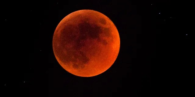 A total lunar eclipse is seen on June 15, 2011 in Jerusalem, Israel. The longest lunar eclipse for a decade took place tonight. A lunar eclipse comes when the sun, Earth and moon line up and Earth's shadow falls on the moon. (Photo by Uriel Sinai/Getty Images)