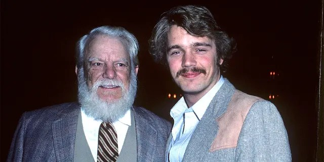 Actor Denver Pyle and actor John Schneider attend the John Wayne Cancer Clinic's Bellamy Scene Beautiful People Awards on March 28, 1982, at the SmokeHouse Restaurant in Burbank, California.
