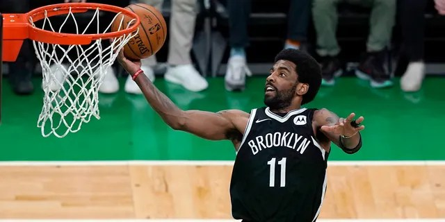 Brooklyn Nets guard Kyrie Irving scores in the first quarter of Game 4 during an NBA basketball first-round playoff series, Sunday, May 30, 2021, in Boston.