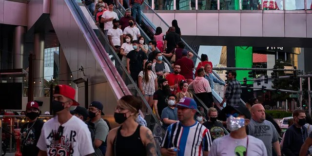 April 24, 2021: Las Vegas is bustling again after casino capacity limits were raised Saturday, May 1, to 80% and person-to-person distancing dropped to 3 feet (0.9 meters).