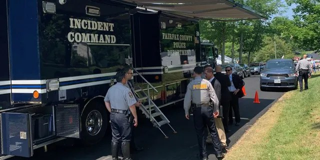 Investigators gather at the scene of Wednesday's double murder in Springfield, Virginia. (Fairfax County Police)