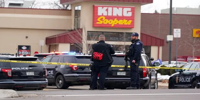 Police work the scene outside of a King Soopers grocery store on March 22 where a shooting took place in Boulder, Colo. (AP)