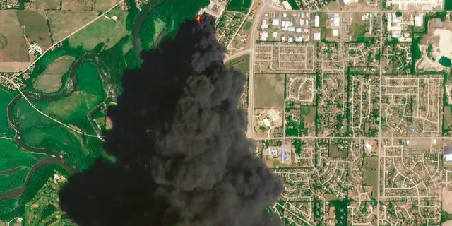 In this Satellite image provided by Planet Labs Inc., a huge plume of smoke and fires can be seen at the Chemtool Inc. plant near Rockton, Illinois, on Monday. A private firefighting company from Louisiana was expected to begin pumping fire-suppressing foam Tuesday onto the still-burning ruins of a northern Illinois chemical plant, a day after it was rocked by anexplosion and massive fires, officials said. (Planet Labs Inc. via AP)