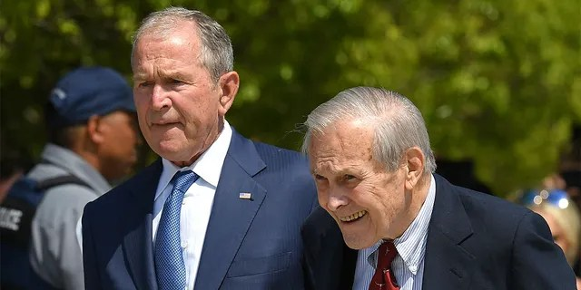 Former US President George W. Bush and Defense Secretary Donald Rumsfeld attend a ceremony to mark the 18th anniversary of the 9/11 attacks, on September 11, 2019, at the Pentagon in Washington, DC. (Photo by MANDEL NGAN / AFP)    (Photo credit should read MANDEL NGAN/AFP via Getty Images)