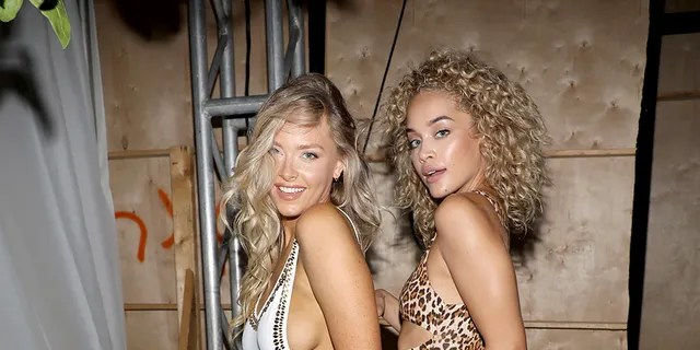 Jasmine Sanders (right) with fellow SI Swimsuit model Camille Kostek.