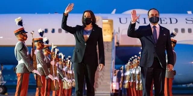 US Vice President Kamala Harris waves alongside Guatemalan Foreign Minister Pedro Brolo upon arrival in Guatemala City on June 6, 2021.
