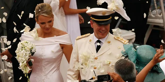 Princess Charlene of Monaco and Prince Albert II of Monaco leave the religious ceremony of the Royal Wedding of Prince Albert II of Monaco to Princess Charlene of Monaco at the Prince's Palace in Monaco.