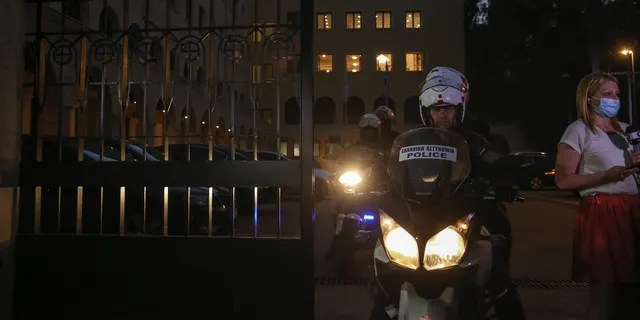 A police officer on a motorcycle exits the Petraki Monastery in Athens, following an attack with a caustic liquid on Wednesday, June 23, 2021. (AP Photo/Petros Giannakouris)
