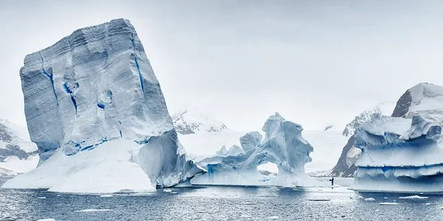 ANTARCTICA, FEBRUARY 2016: Stunning icebergs the size of small countries threaten to collapse, taken in February 2016, Antarctica. (Credit: Freedive Antarctica / Barcroft M / Barcroft Media via Getty Images)