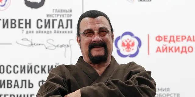 American actor Steven Seagal (front), chief instructor at the Russian Aikido Federation, poses during the International Aikido Festival held at the RMK Academy of Martial Arts. Donat Sorokin/TASS