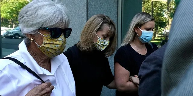 Allison Mack (C) arrives at Brooklyn Federal Court on June 30, 2021 in New York. She was sentenced to three years in prison for her role in NXIVM.
