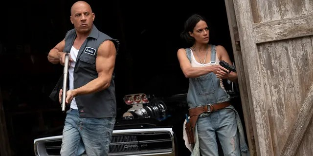 """This image released by Universal Pictures shows Vin Diesel, left, and Michelle Rodriguez in a scene from """"F9: The Fast Saga."""""""