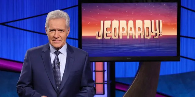 """This image released by Jeopardy! shows Alex Trebek, host of the game show """"Jeopardy!"""" Filling the void left by Trebek after 37 years involves sophisticated research and a parade of guest hosts doing their best to impress viewers and the studio that will make the call."""