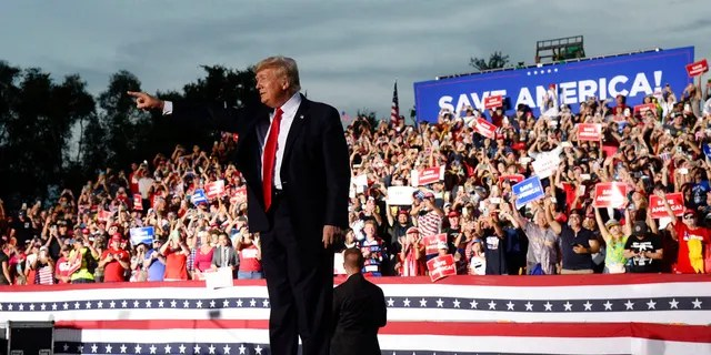Former President Donald Trump walks on stage during a rally at the Sarasota Fairgrounds Saturday, July 3, 2021, in Sarasota, Fla. (AP Photo/Jason Behnken)