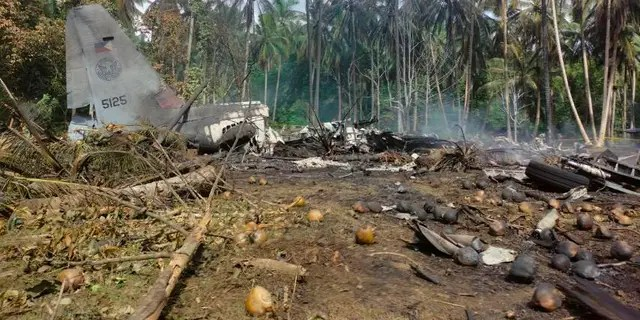 THIS CORRECTS THE NAME OF THE PROVINCE TO SULU, INSTEAD OF JOLO - This photo released by the Joint Task Force - Sulu shows the remains of a Philippine military C-130 plane that crashed in Patikul town, Sulu province, southern Philippines on Sunday, July 4, 2021. The Philippine air force C-130 aircraft carrying troops crashed in a southern province after missing the runway Sunday, killing more than a dozen military personnel while at least 40 were rescued from the burning wreckage, officials said. (Joint Task Force-Sulu via AP)