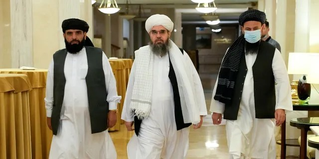 Members of political delegation from the Afghan Taliban's movement Suhil Shaheen, left, Mawlawi Shahabuddin Dilawar, center, and Dr, Mohammad Naim, arrive to attend a news conference in Moscow, Russia, Friday, July 9, 2021. (AP Photo/Alexander Zemlianichenko)