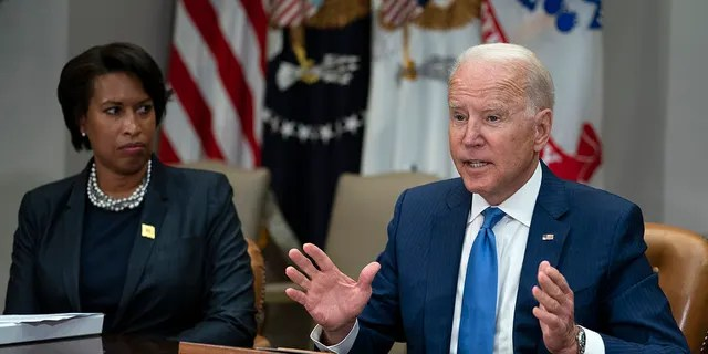 Washington Mayor Muriel Bowser listens as President Joe Biden speaks during a meeting on reducing gun violence, in the Roosevelt Room of the White House, Monday, July 12, 2021, in Washington. (AP Photo/Evan Vucci)