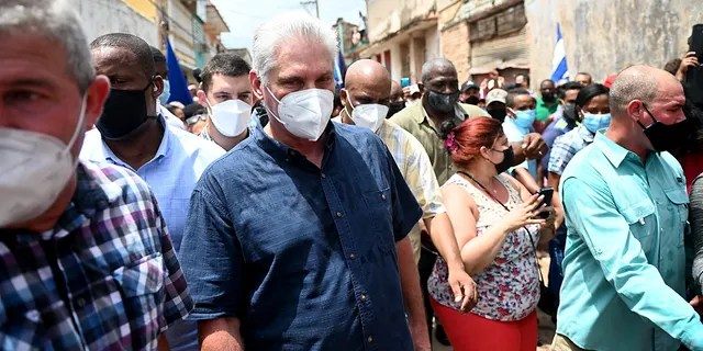 Cuban President Miguel Diaz-Canel is seen during a demonstration held by citizens to demand improvements in the country, in San Antonio de los Banos, Cuba, on July 11, 2021. (Photo by Yamil LAGE / AFP) (Photo by YAMIL LAGE/AFP via Getty Images)