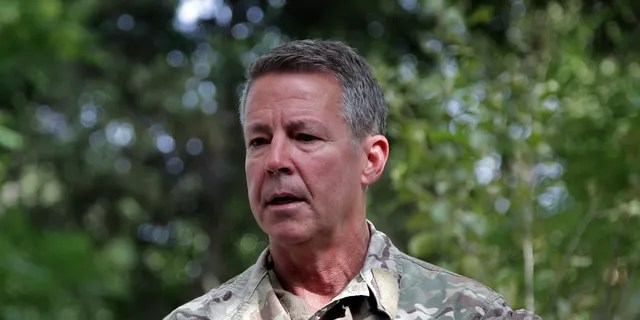 FILE - In this June 29, 2021 file photo, U.S. Army Gen. Scott Miller, the U.S.'s top general in Afghanistan, speaks to journalists at the Resolute Support headquarters, in Kabul, Afghanistan. Miller is to hand over his command at a ceremony in the capital of Kabul on Monday, July 12, 2021, as America winds down its 20-year military presence and Taliban insurgents continue to gain territory across the country. (AP Photo/Ahmad Seir, File)