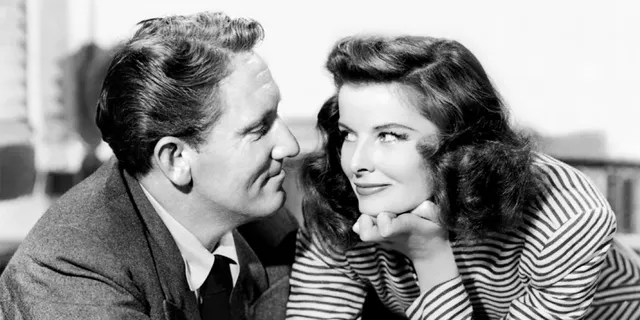 Actors Spencer Tracy as Sam Craig and Katharine Hepburn as Tess Harding in the romantic comedy film 'Woman of the Year', 1942.