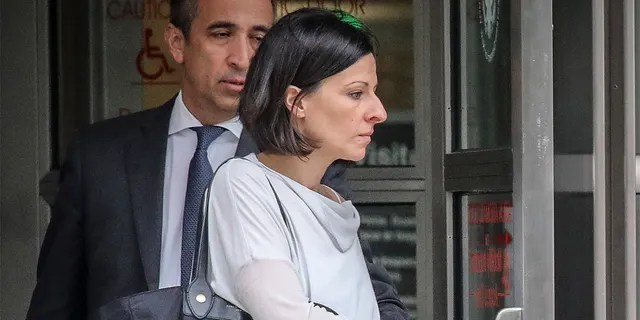 FILE - This Oct. 4, 2018 photo shows Lauren Salzman as she leaves Brooklyn Federal Court in New York. Salzman, a former member of NXIVM leader Keith Raniere's inner circle in his sex trafficking enterprise avoided prison at sentencing Wednesday, July 28, 2021 after prosecutors cited her extraordinary cooperation.