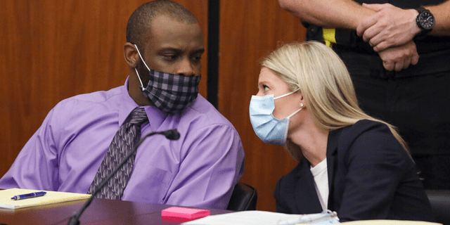 Defendant Nathaniel Rowland speaks with his attorney, Alicia Goode, right, during his trial in Richland County Court, Tuesday, July 20, 2021, in Columbia, S.C.