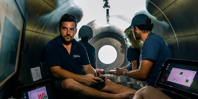 This undated photo provided by OceanGate Expeditions in June 2021 shows the interior of company's Titan submersible. The undersea exploration company plans to dive to the sunken Titanic as early as Wednesday, June 30, 2021, to begin what's expected to be an annual chronicling of the shipwreck's ongoing deterioration. (OceanGate Expeditions via AP)