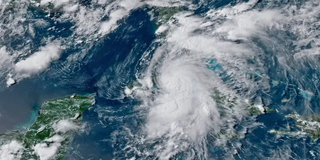 This GOES-16 GeoColor satellite image taken Monday, July 5, 2021, at 4:50 p.m. EDT, and provided by NOAA, shows Tropical Storm Elsa over western Cuba with strong rain and winds. Forecasters say it will move on to the Florida Keys on Tuesday and Florida's central Gulf coast by Wednesday. (NOAA via AP)
